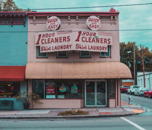 A photo of a dry cleaner store showing exterior signage.